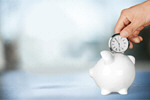 Сlipart Hand holding watch and piggy bank on the table Time Savings Time is Money Clock   BillionPhotos